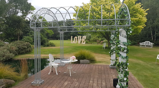 Outdoor wedding arch and table setting